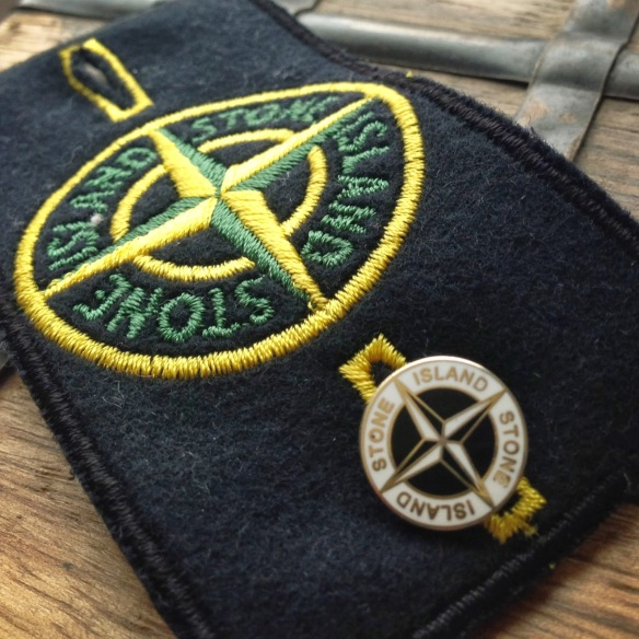 stone island logo badge
